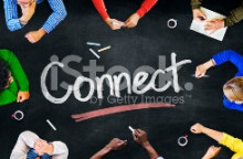 Picture of arms of people sitting round table with word Connect on the table